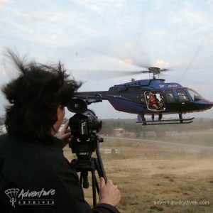 Cameraman Recording Helicopter