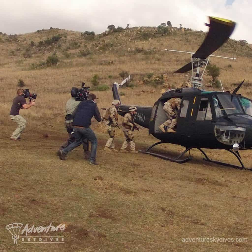 Camera Crew Recording Actors Jumping Into Helicopter